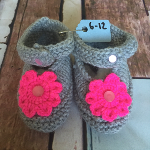 Grey crochet booties with bright pink flower