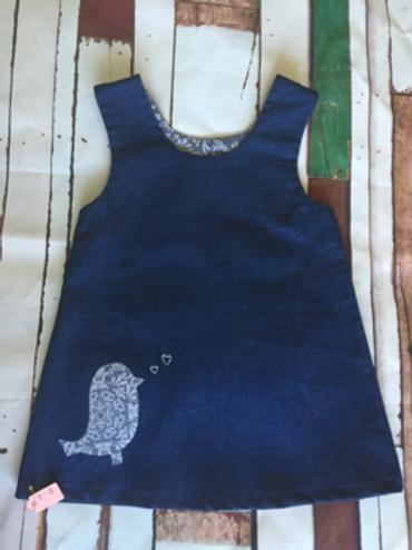 Blue girls pinafore dress with floral print bird