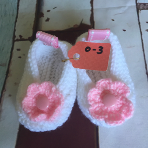 White crochet booties with light pink flower