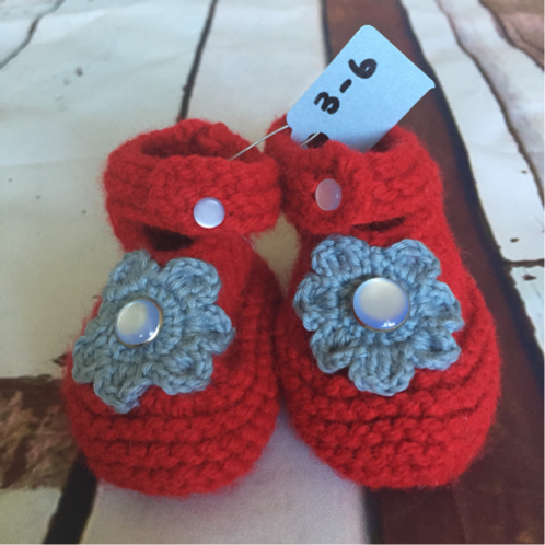 Red crochet booties with grey flower