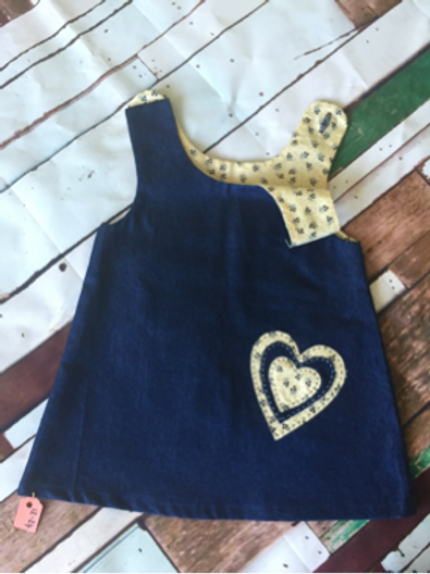 Blue girls pinafore dress with cream heart detail