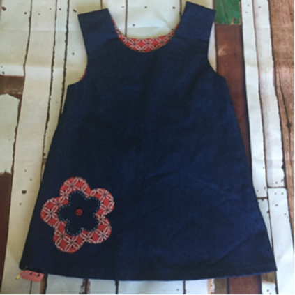 Blue girls pinafore dress with red flower detail