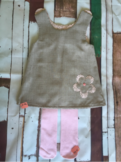 Beige girls pinafore dress with pink leggings