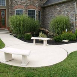 White concrete sidewalk with sitting are