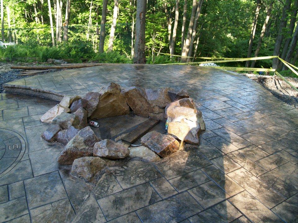 Ashlar slate patio with fire ring