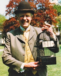 Victor with canary in cage SHSL Swiss Pilgrimage 1987