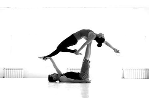 couple-practicing-acro-yoga-white-260nw-