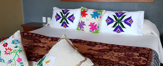 King size bed in Iguana Room of Casa Arcoiris