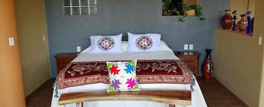 King bed in Pez Vela Room of Casa Arcoiris