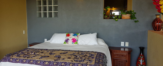 Decorated bed in Pez Vela Room
