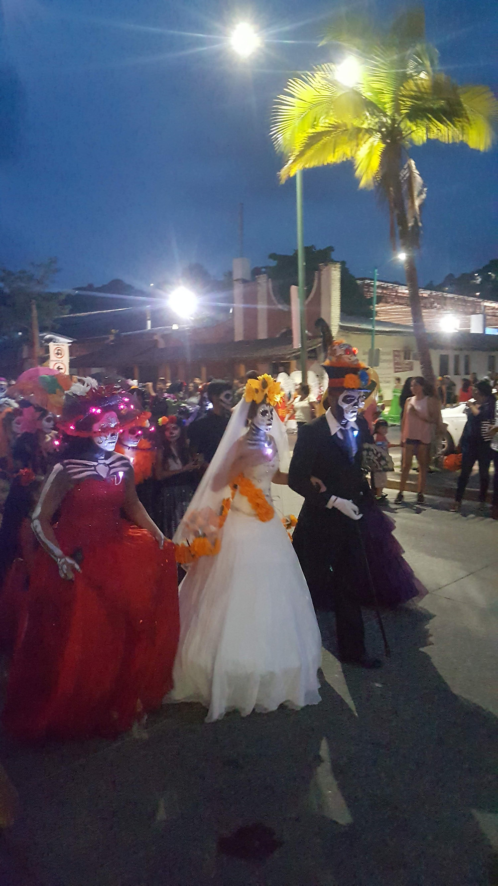 This is a picture of people dressed up as catrinas in Dia de muertos observances in Zihuatanejo