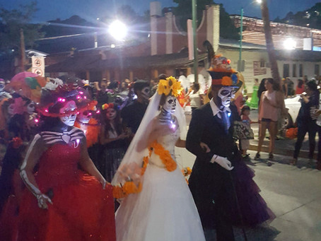 Parade of catrinas for Dia de los muertos