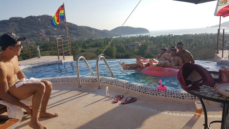 Gay friends enjoying the pool