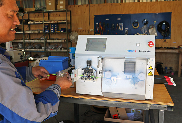 Eugene-uses-the-Cut and Stripping Machine.jpg