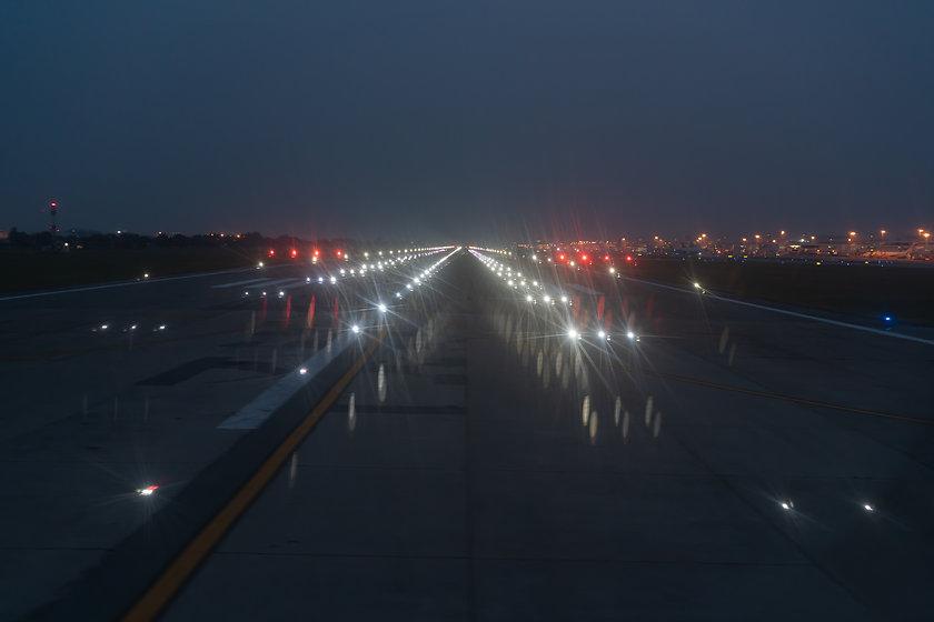 Landing lights ON A airport runway at ni