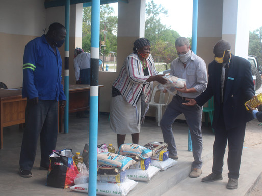 Wilderness Safaris' donates food hampers to rural communities - 4th time running