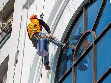 hanging man in yellow shirt painting apa