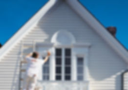 Painting the exterior of a home with white paint. Painting done in Frederick, MD