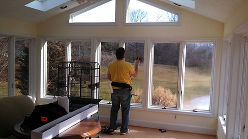 man in yellow shirt window tinting a hom