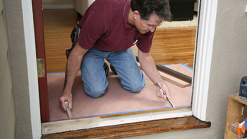 Man measuring insulation for door washington dc