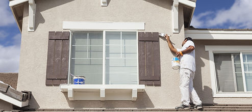 man exterior painting a roof in Germanto
