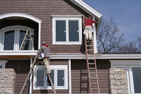 2 guys on a ladder painting exterior in