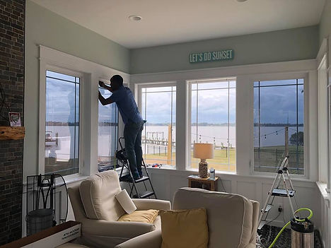 man on the ladder window tinting a home Bethesda Maryland