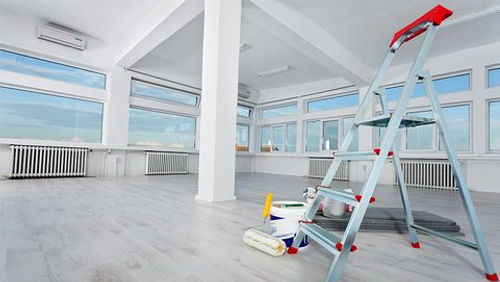 Interior of commercial business. Painting tools & ladder set upto complete work in Frederick based business.