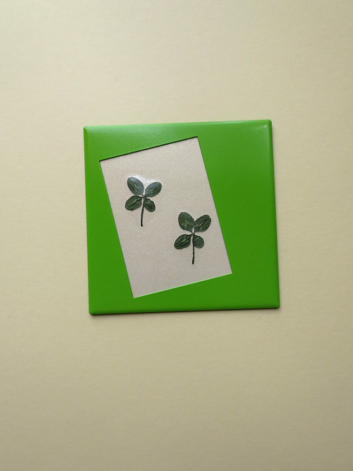 Fridge magnet with two four-leaf clovers