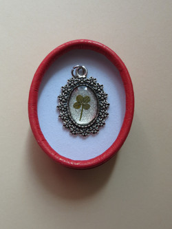 Very tiny four-leaf clover in resin