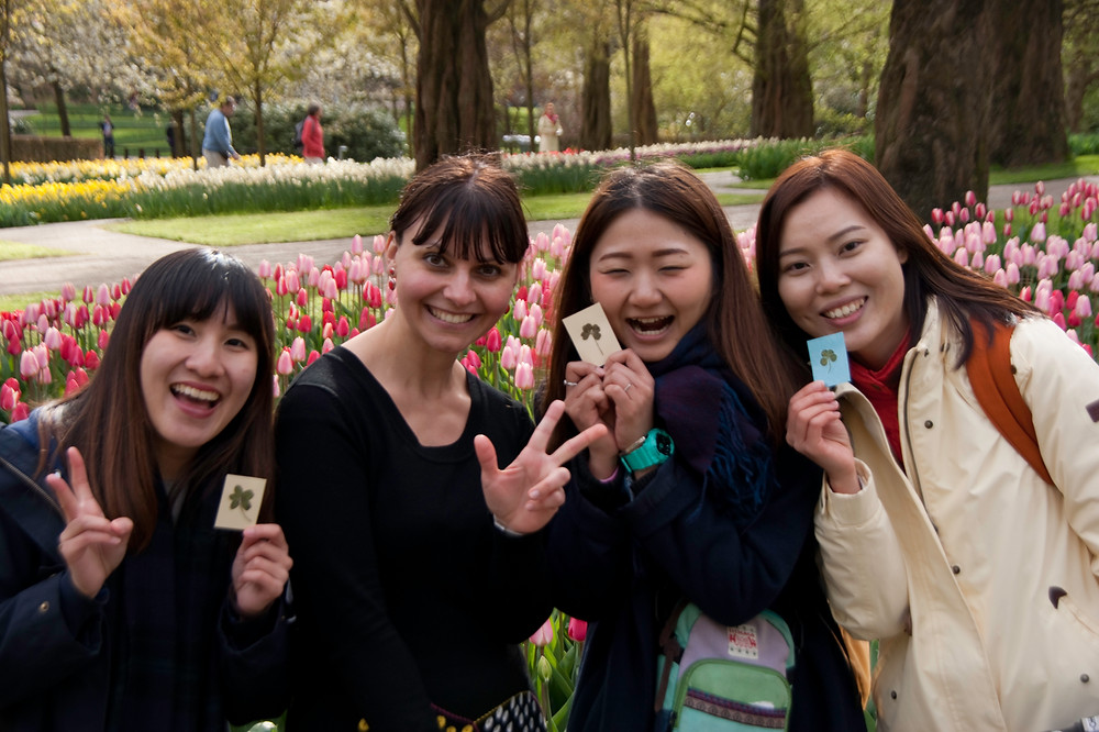 tourists from Hong Kong happy with their four-leaf clover gifts