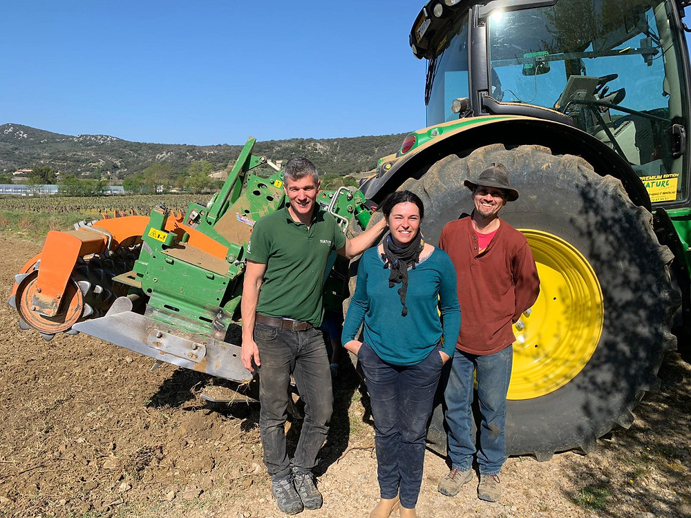 Stephan Picas of Nature Languedoc, Hélène Taillefer and Glen Creasy standing by the tractor and chisel after completion of the work