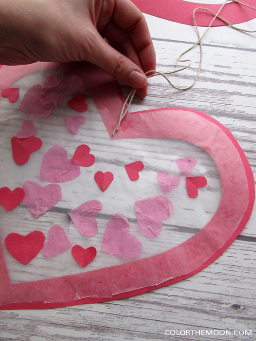 This Valentine's Day sun catcher is SO PRETTY and so easy to make! What a great holiday craft for the kids!