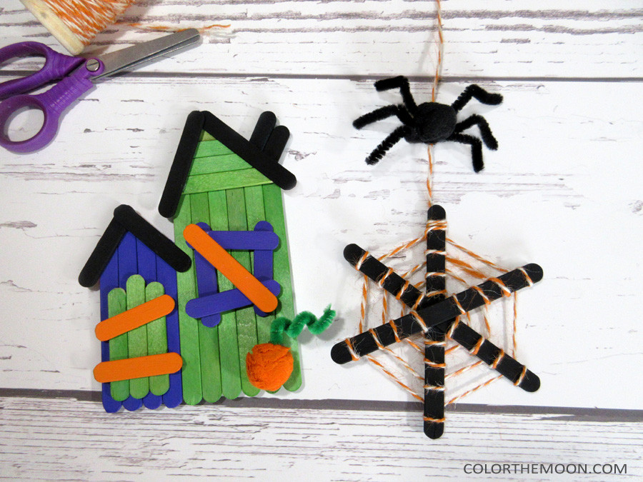 This popsicle stick haunted house and spider web craft is SO EASY to make! What a great Halloween craft for kids!