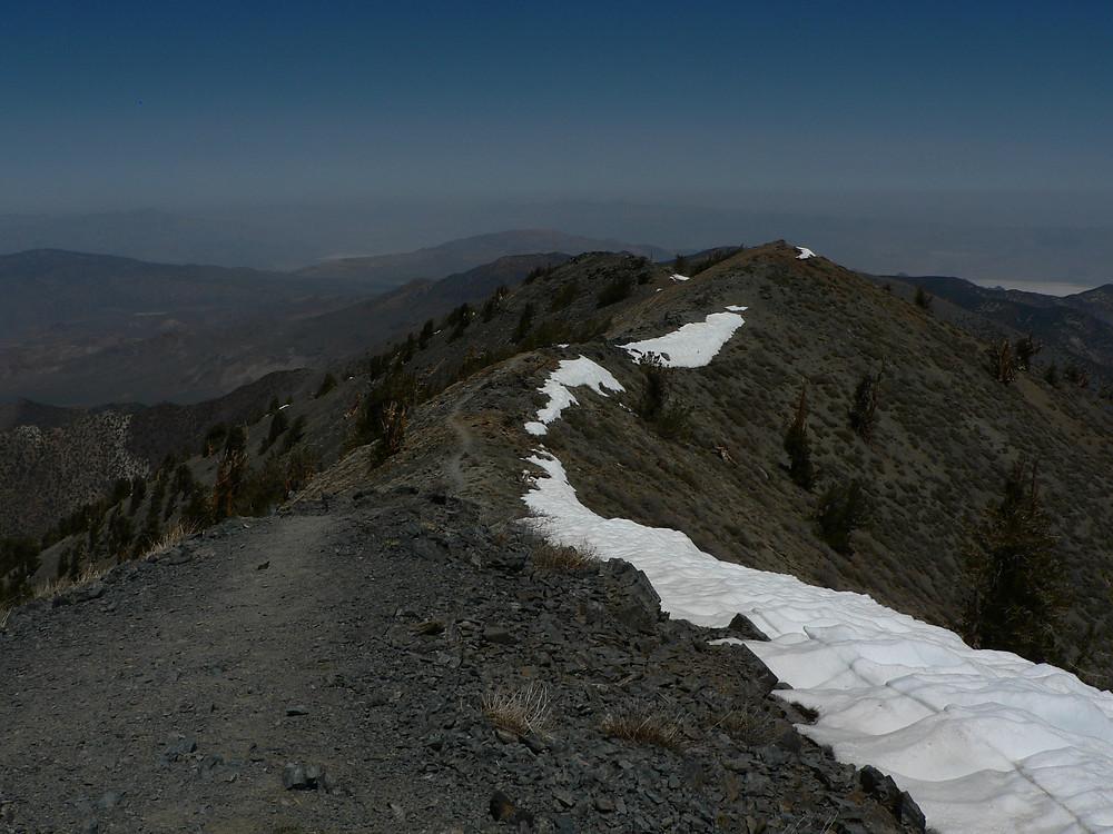 Hiking trail on ridgeline with snow