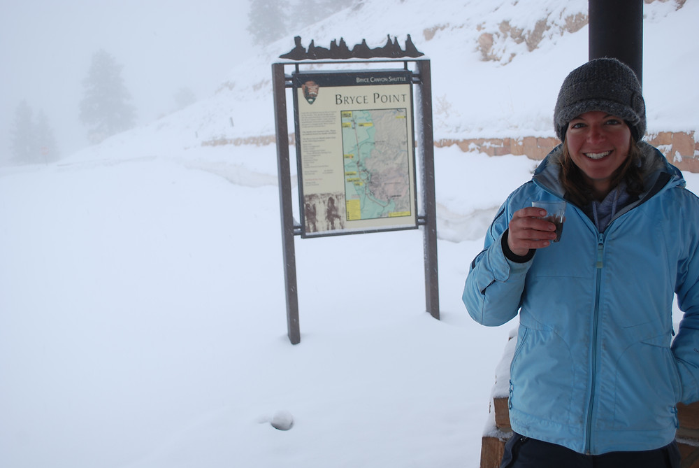 snow-covered sign for capitol reef national park