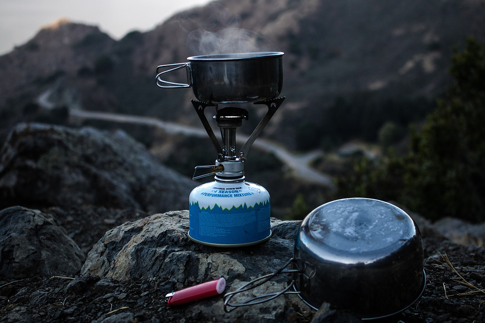Camp stove and pot cooking in the outdoors