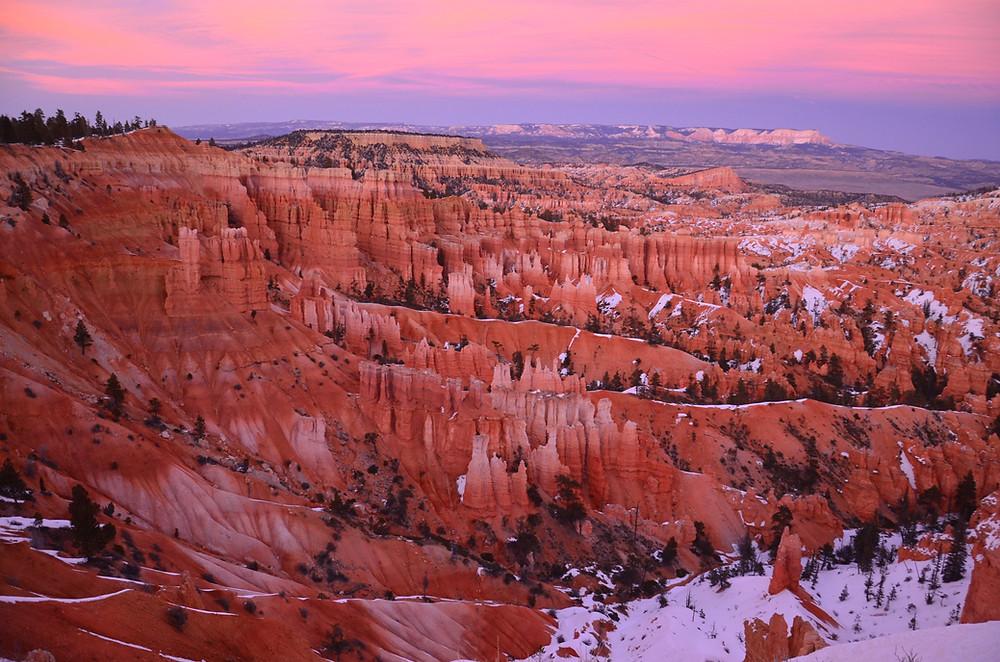 pink skies, orange rock, white ground