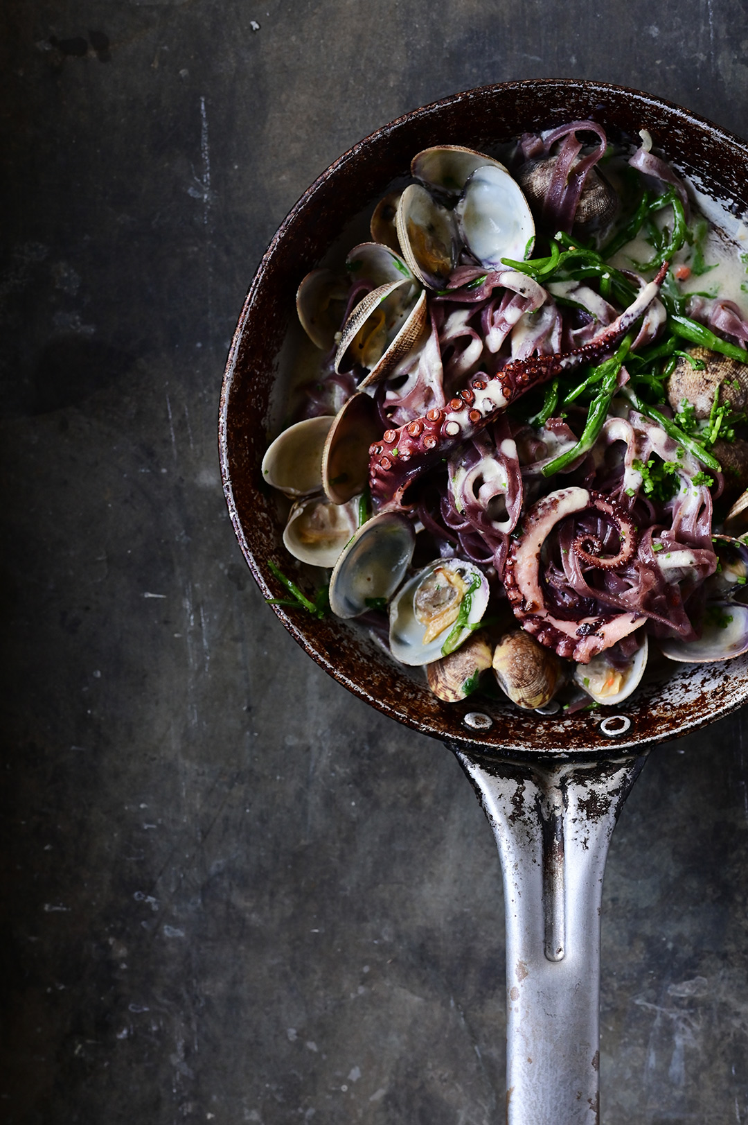 Creamy garlic black pasta with clams and