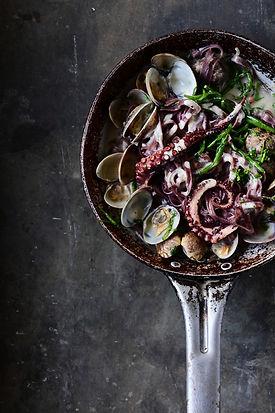 Creamy garlic black pasta with clams and
