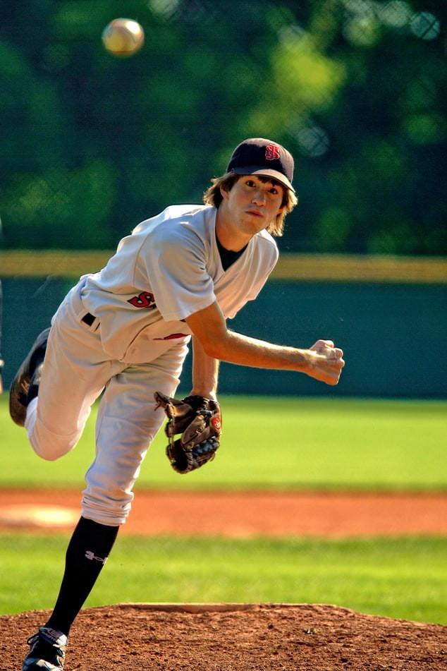 baseball player practising his pitch