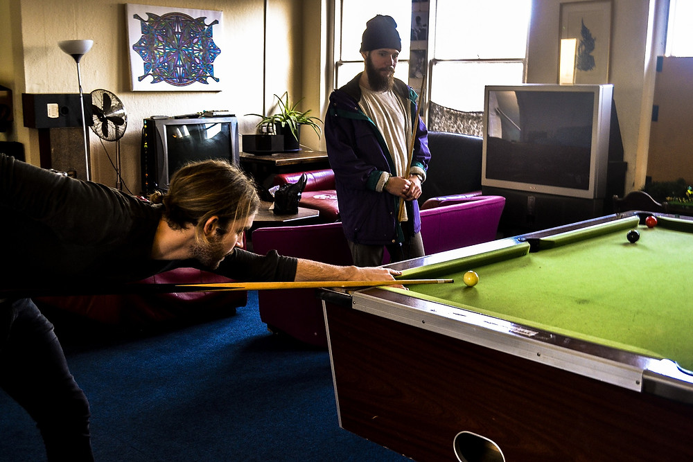 two guys play snooker pool billiards game