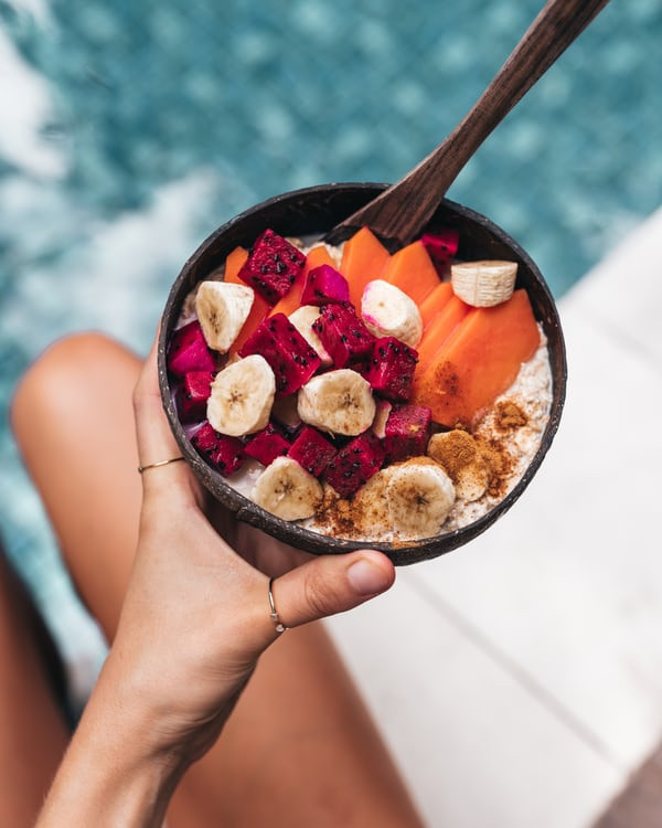 Healthy bowl of fruits by the pool