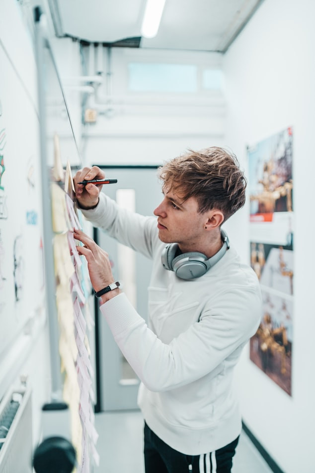 Young man making art