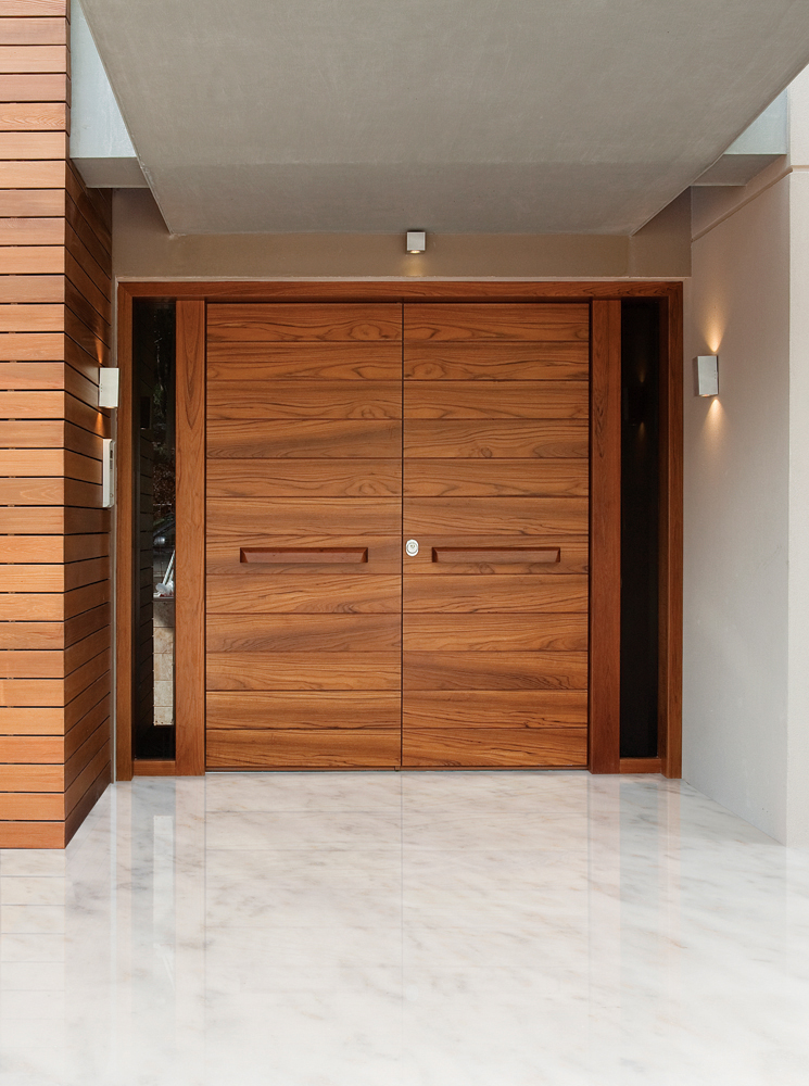 Double door covered with teak wood and steady side parts made of glass