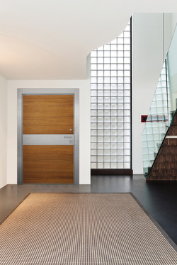 Pivot Door covered with teak wood and stainless steel inset
