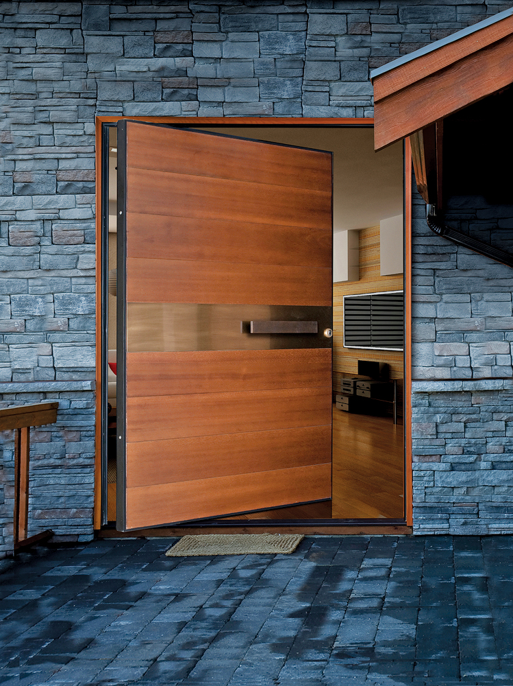 Pivot Door covered with meranti wood and cooper inset