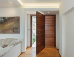 Hinge Door covered internal with meranti wood and steady side part made of the same material..