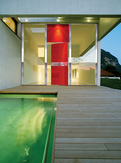 Pivot Door covered with glass insets and upper steady part made of the same material