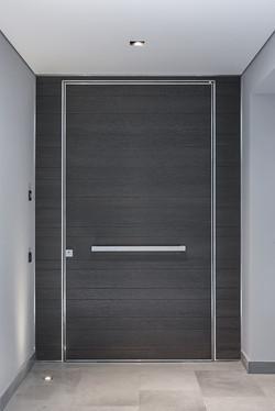 Pivot Door covered with oak veneer